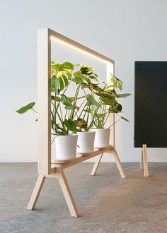 """""""Don´t we all wish to work next to a green window? GreenFrame floor screens by Glimakra of Sweden embraces greenery and enlightens your favorite potted plants."""" Designer: Johan Kauppi GreenFrame is a floor screen for…"""