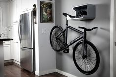 space-saving bike storage ideas for small apartments. Indoor bike storage solutions are for people who can't part with their bicycle. Indoor Bike Storage, Indoor Bike Rack, Bike Storage Rack, Indoor Cycling, Hanging Bike Rack, Bike Hanger, Bicycle Rack, Bicycle Wall Mount, Bike Mount