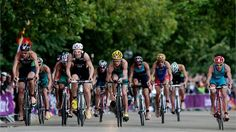 Steffen Justus of Germany, Reinaldo Colucci of Brazil and Brad Kahlefeldt of Australia compete in the cycling portion of the men's Triathlon on Day 11 of the London 2012 Olympic Games at Hyde Park.