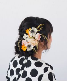 A pretty floral updo with flowers from your garden
