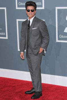 Bruno Mars in a gray suit.