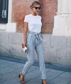 Striped pants, white tee, low bun.
