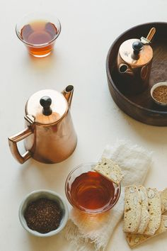 Tea in copper pots with biscotti