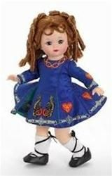 $71.96 Little Irish Dancer. You will love this Little Irish Dancer as she step dances right into your heart. She has long red ringlets and is dressed in her royal blue satin traditional style step dancing dress accented with embroidered Celtic symbols and bottom pleats. She wears traditional black dancing slippers. Retired, limited supply.