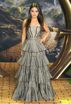 Mila Kunis working it in a tiered, strapless Alexander McQueen stunner at the London premiere of Oz the Great and Powerful ... nuff said!
