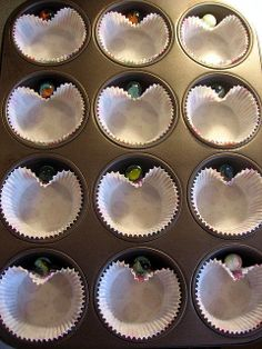 A marble in between the cupcake liner and the tin.... and you have yourself some heart-shaped cupcakes!