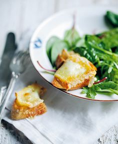 Warm Goat Cheese Salad Recipe (This warm goat cheese salad recipe is essentially just slices of baguette slathered with goat cheese, baked to toasty perfection, and accompanied by a simple green salad with a can't-mess-it-up vinaigrette. A French classic.)
