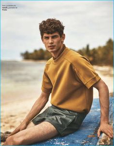 Arthur Gosse wears a Canali top with leather Prada shorts.