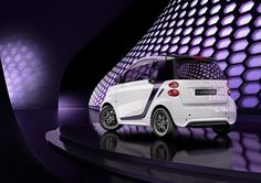 """smart goes glam to debut the special edition nightpurple. Named for the brilliant violet color of its tridion cell, each of the 90 exclusive coupe models combines innovative technology with sleek design. The coupe features shimmering crystal white body panels, matte finish 15"""" BRABUS Monoblock VII wheels and LED daytime running lamps. Inside, you'll find black fabric upholstery, electric power steering and heated seats — everything you need to arrive in style. So put on your evening best and…"""