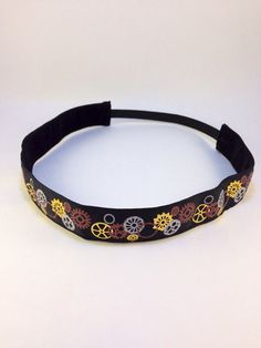 Black & gold foil steampunk inspired gears non-slip headband for everyday and active wear on Etsy, $8.00