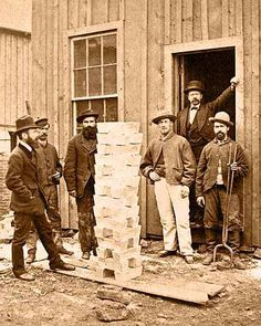 Photo of 30 Bars of Silver in Black Hawk, Colorado, 1878.  Photo taken in Black Hawk in front of the the Boston & Colorado Gold and Silver Smelting Co.. Nathaniel Hill, manager of the smelter is standing in front door. Superintendent Pearce is standing at the far left with his hand in his pocket.