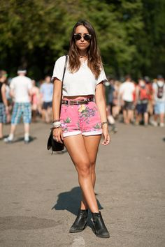 Love her sunglasses and high waisted shorts