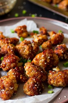 These Sticky Spicy Sesame Cauliflower Wings are the best veggie wings I've ever had! Loaded with a maple sesame flavor and spice, they are the perfect game day snack for vegans!
