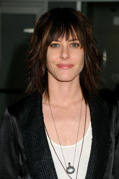 Laura (Katherine Moennig)