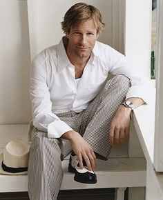 Aaron Eckhart - I feel he has the loveliest hands. I'm always watching his hands and the way he moves them