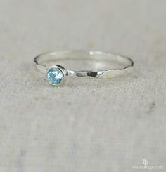 These dainty rings make a stunning fashion statement! This thin silver band is set with a dainty 3mm Aquamarine blue conflict free cubic zircon - March's birthstone! These rings are beautifully worn a