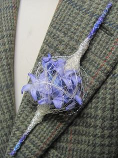 For the modern groom - try this pretty contemporary sceptre style boutonniere, with blue hyacinth pips encased in fine decorative silver wire. By http://www.branchingdesign.com/gallery_178624.html