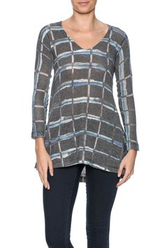 Plaid printed tunic top with a v-neckline, 3/4 sleeves and a subtle high low hem.Hand Wash. Lay Flat to Dry.   Plaid V-Neck Tunic by Nally & Millie. Clothing - Tops - Tunics Clothing - Tops - Long Sleeve Cape Cod, Massachusetts