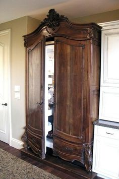 Refrigerator in an antique armoire We are restoring an old Victorian house, currently DIY-ing the kitchen remodel… trying to figure out how to hide the refrigerator. Panel ready is expensive! Considering under counter refrigerators and armoire styles! Home Renovation, Home Remodeling, Kitchen Remodeling, Remodeling Contractors, Küchen Design, Interior Design, Design Ideas, Diy Interior, Old Victorian Homes