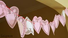 Valentines Day Heart Doily Garland - simple kid-made decoration that can be used as a Valentine themed busy bag