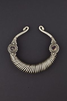 Chitral Valley, Pakistan | Early 20th century silver and glass necklace.