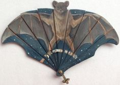 Hand painted, exceptionally rare miniature bat fan.  On thin shaved wood.  Circa 1900.