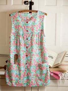 Floral Smock  Apron   $29.95  Sized Like a Button-Down Shirt, This Old-Fashioned Smock Apron Protects Clothing and Fits Like a Glove