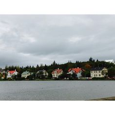 Houses by the lake in Reykjavik city centre. #Reykjavík #houses #colourful #orange #blue #green #cream #lake #Nordic #charming #Iceland #travel #coolplaces #memories (scheduled via http://www.tailwindapp.com?utm_source=pinterest&utm_medium=twpin&utm_content=post112421955&utm_campaign=scheduler_attribution)