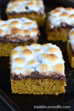 Spicy pumpkin bars topped with a melted chocolate and marshmallow layer. This is a summer meets fall treat that you cannot miss out on.