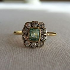 Antique Emerald and Diamond Halo Ring. Early 1900s