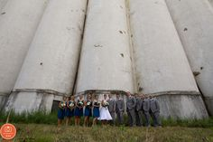 teal dresses, tea length dress, wedding party, group photo, grain elevator, silo city, buffalo www.shweddingphotos.com #wedding #weddingphotography #love  #weddingparty  #bridesmaids #bride #groomsmen #groom  #buffalove #buffalo