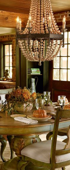 Rustic Dining and beautiful beaded chandelier