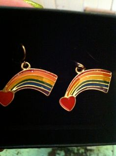 If only I could actually earrings, they'd be MINE! :(    80s RAINBOW HEART EARRINGS Red Hearts with Rainbow Trails and Glitter. $11.99, via Etsy.