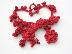 Handmade coral red crochet necklace. €80,00, via Etsy.