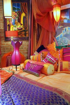 Bold rich room colors, indigo, turquoise, purple, hot pink, emerald green, dark red, brown and golden colors, combined with glossy finishes, create stunning Boho-chic home decor. Hand Crafted Custom Made Cushions With Feather Inserts And Coordinating Bedding Throws And Bedding by Jane Hall.