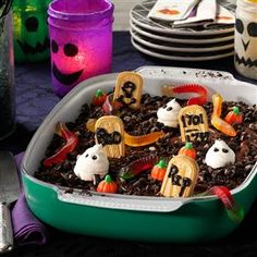 """Graveyard Cake Recipe- Recipes  Underneath tasty """"tombstones,"""" ghosts, pumpkins, """"worms"""" and """"soil"""" that make this dessert a conversation piece, you'll find a delectable chocolate cake made from scratch in a few simple steps. It's a recipe I use year-round with different frostings. —Vicki Schlechter, Davis, California"""
