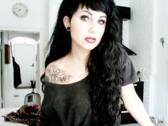 This girl is gorgeous! She makes me want black hair again.