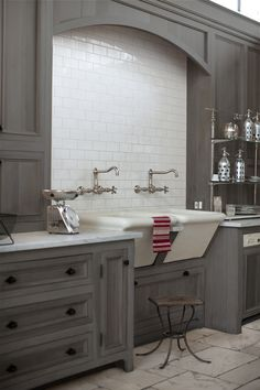 grey cabinetry & white subway tile. Love those double sinks!