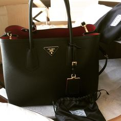 Prada double bag! I fell in love with it when I was in Paris last yr. Just got it to see if I want this black or the red. I love the black so much but too similar to my LV Montaigne girl! So well made. So beautiful!