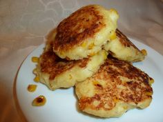 These little Venezuelan griddle cakes, known as arepas in Spanish, can be eaten at any time of the day, topped with cheese, meat, chicken, or eggs. You can top them with roast pork or a spoonful of pico de gallo as a delicious side or tempting appetizer. You use nonstick cooking spray quite a bit for this, but I like to use an olive oil spritzer. Enjoy!