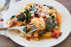 A homemade ricotta gnocchi finished in a skillet with garden vegetables. These are easy to make and come together in under 30 minutes.