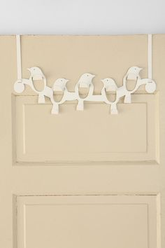 Lovely White Bird Coat Hooks: I have enough door hooks for every door in the house, but I love this one!  For the shed maybe?