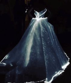 and the winner is: The theme of this year's Met Ball, fittingly sponsored by Apple, was Manus x Machina: Fashion in an Age of Technology, and Claire Danes' dress took the cake. Designed by Zac Posen, he sourced the fiber optic woven organza in this dress from France, and there are 30 mini battery packs sewn into the gown's understructure