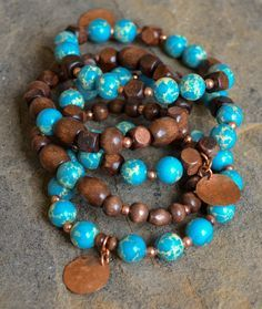 """Turquoise jasper, wood, copper spacers and hammered, copper discs. Bracelets fit 6.5"""" - 7"""" wrist. Includes 5 bracelets, with 3 copper charms. Customization available upon request."""