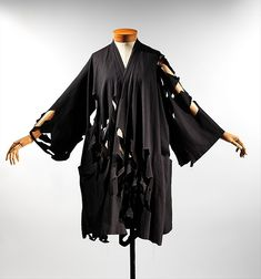 Coat Designer: Yohji Yamamoto (Japanese, born Yokohama, 1943) Date: spring/summer 1983 Culture: Japanese Medium: cotton Dimensions: Length at CB: 43 in. (109.2 cm)
