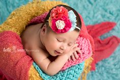 Colorful newborn girl forward-facing bucket setup coral fuchsia yellow aqua blue mint pink polka dot bucket smiling newborn | Bella Rose Portraits newborn photographer photography