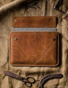 This case is made of classic saddle Crazy Horse leather, it's one of our favorite, really beautiful color and texture. We got just few leathers so this is limited edition series, hurry if you like it! Two business and credit card pockets. nDESIGNED FOR: MacBook 12 inch MacBook Pro 13 inch MacBook Air 13 inch MacBook Air 11 inch iPad Pro iPad Air 2 / 1 iPad 4 / 3 / 2 Our products are made using only natural materials, like 'crazy horse' type leather and natural wool felt. It's one of the