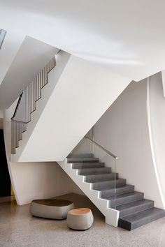 This modern staircase uses solid slab honed bluestone for the stair treads and rises.