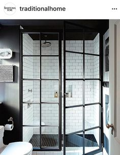 A great example of a modern farmhouse bathroom design, the glass shower enclosure really is the iconic piece of the design. Bathroom Doors, Bathroom Renos, Small Bathroom, Bathroom Ideas, Bathroom Remodeling, Bathroom Black, Bathroom Designs, Bathroom Faucets, Serene Bathroom