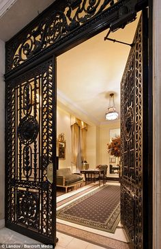 Joan Rivers - foyer - In demand: In 2009, Libyan dictator Colonel Gaddafi allegedly asked to rent the penthouse of the limestone mansion with a cast-iron front door